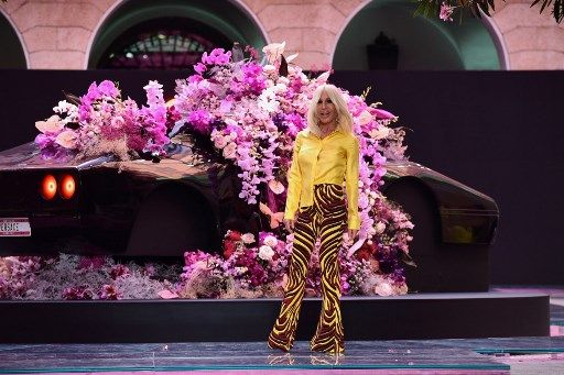 Italian fashion designer Donatella Versace acknowledges applause following the presentation of fashion house Versace's women's and men's spring/summer 2020 fashion collection in Milan on June 15, 2019. (Photo by Miguel MEDINA / AFP)