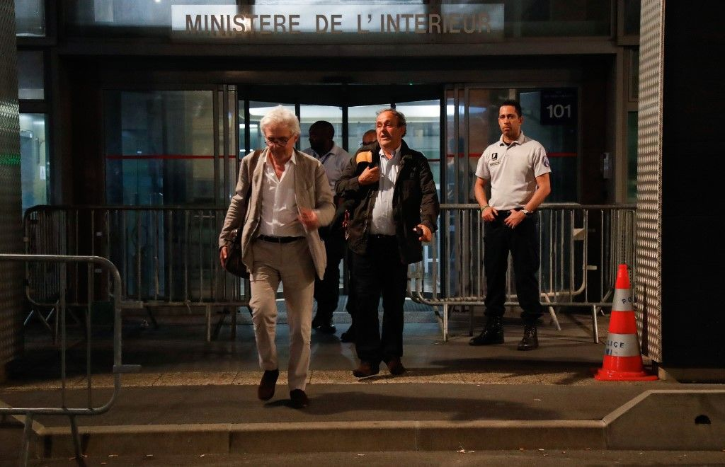 "Ex-UEFA chief Michel Platini (R), flanked by his lawyer William Bourdon (L), leaves the Central Office for Combating Corruption and Financial and Tax Crimes after being arrested in connection with a criminal investigation into the award of the 2022 World Cup to Qatar, in Nanterre, west of Paris in the early hours of June 19, 2019. - The banned ex-UEFA chief Michel Platini was freed from French custody Wednesday, an AFP journalist said, after several hours of questioning in connection with a criminal investigation into the awarding of the 2022 World Cup to Qatar. ""He is no longer in custody,"" William Bourdon, the lawyer of the French football legend, said shortly before 1:00 am. There had been ""a lot of fuss over nothing"", he added. (Photo by Zakaria ABDELKAFI / AFP)"