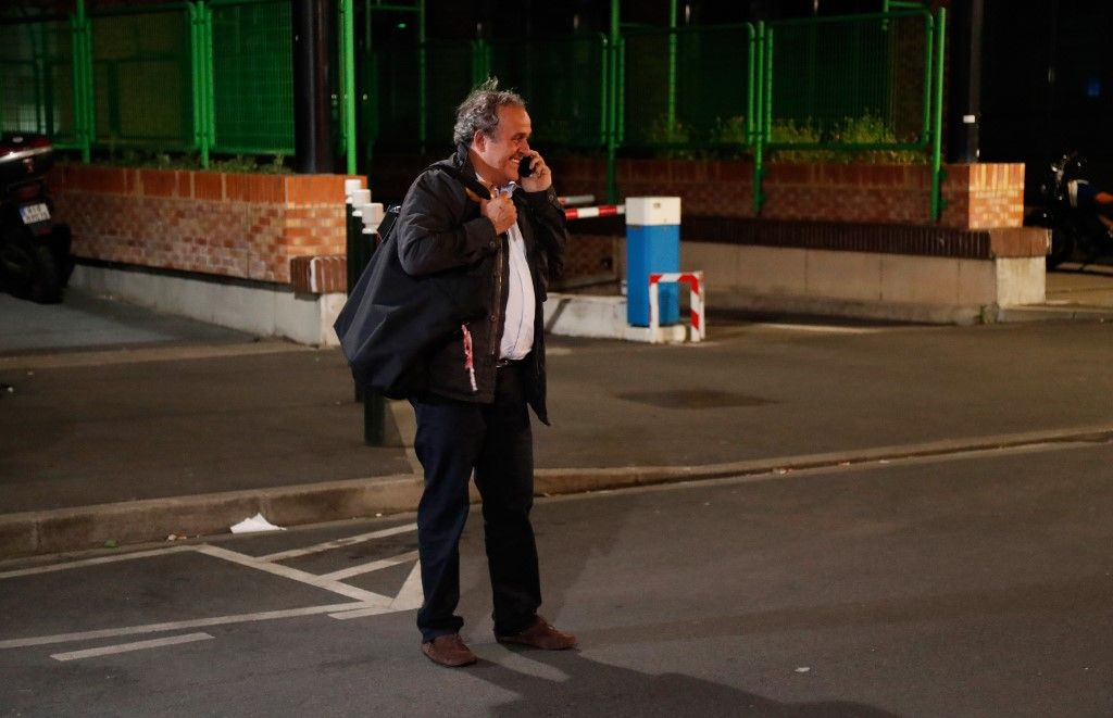 "Ex-UEFA chief Michel Platini, flanked by his lawyer William Bourdon, talks to the media as he leaves the Central Office for Combating Corruption and Financial and Tax Crimes after being arrested in connection with a criminal investigation into the award of the 2022 World Cup to Qatar, in Nanterre, west of Paris in the early hours of June 19, 2019. - The banned ex-UEFA chief Michel Platini was freed from French custody Wednesday, an AFP journalist said, after several hours of questioning in connection with a criminal investigation into the awarding of the 2022 World Cup to Qatar. ""He is no longer in custody,"" William Bourdon, the lawyer of the French football legend, said shortly before 1:00 am. There had been ""a lot of fuss over nothing"", he added. (Photo by Zakaria ABDELKAFI / AFP)"
