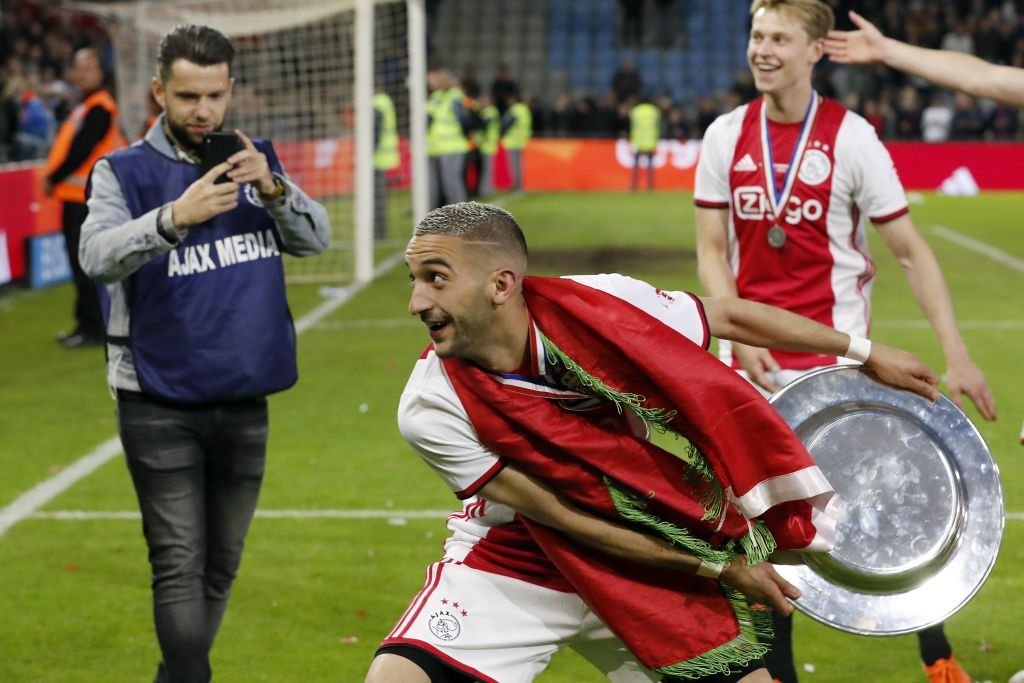 Hakim Ziyech of Ajax with the Dutch Eredivisie trophy, dish during the Dutch Eredivisie match between De Graafschap Doetinchem and Ajax Amsterdam at De Vijverberg stadium on May 15, 2019 in Doetinchem, The Netherlands(Photo by VI Images via Getty Images)