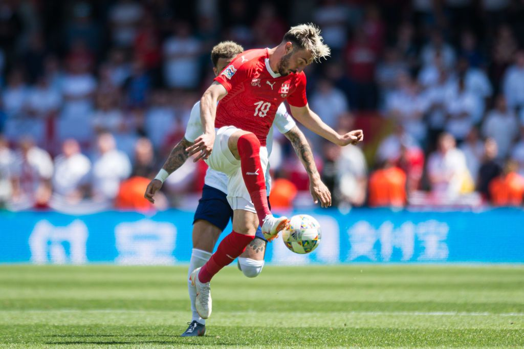 GUIMARAES, PORTUGAL - JUNE 09: Kyle Walker of England and Josip Drmic of Switzerland battle for the ball during the UEFA Nations League Third Place Playoff match between Switzerland and England at Estadio D. Afonso Henriques on June 9, 2019 in Guimaraes, Portugal. (Photo by TF-Images/Getty Images)