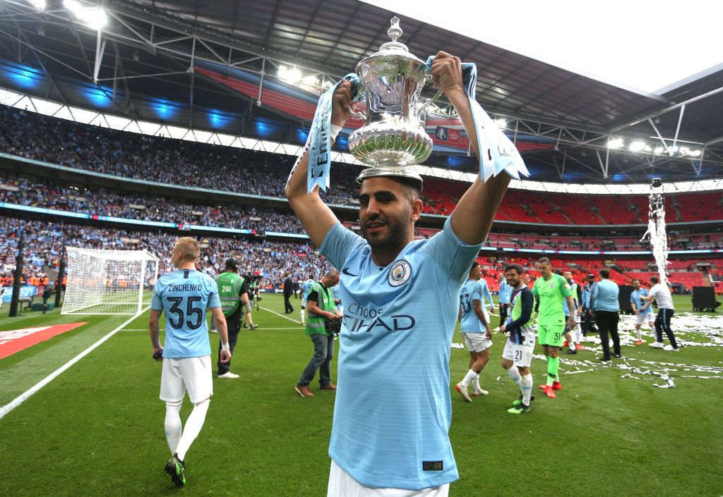 LONDON, ENGLAND - MAY 18: Riyad Mahrez of Manchester City celebrates with the trophy after victory in the FA Cup Final match between Manchester City and Watford at Wembley Stadium on May 18, 2019 in London, England. (Photo by Victoria Haydn/Man City via Getty Images)