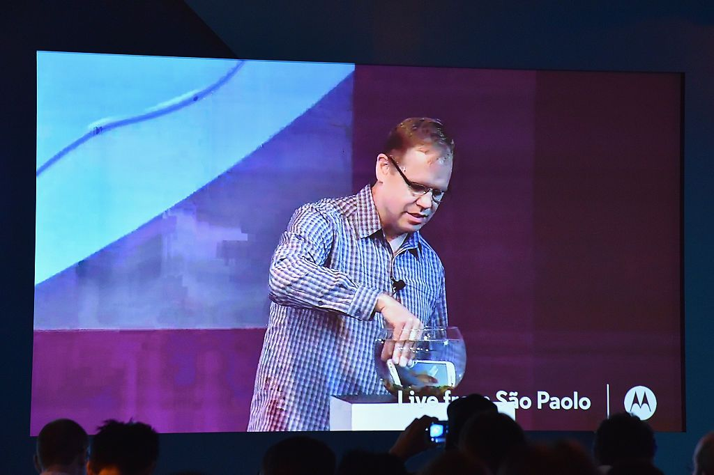 NEW YORK, NY - JULY 28: Steve Sinclair, Motorola Vice President of Product Marketing, demonstrates advanced water resistance on the new Moto G smartphone from a global Livestream event in Sao Paulo, Brazil on July 28, 2015. (Photo by Mike Coppola/Getty Images for Motorola Mobility)