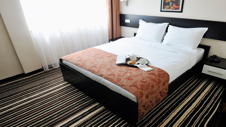 bright and clean hotel room interior with modern furniture