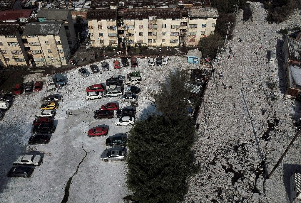 Aerial view of Guadalajara, Jalisco State, Mexico, taken on June 30, 2019 after a hail storm fell in the area. - A freak hail storm on Sunday struck Guadalajara, one of Mexico's most populous cities, shocking residents and trapping vehicles in a deluge of ice pellets up to two metres deep. (Photo by Ulises RUIZ / AFP)