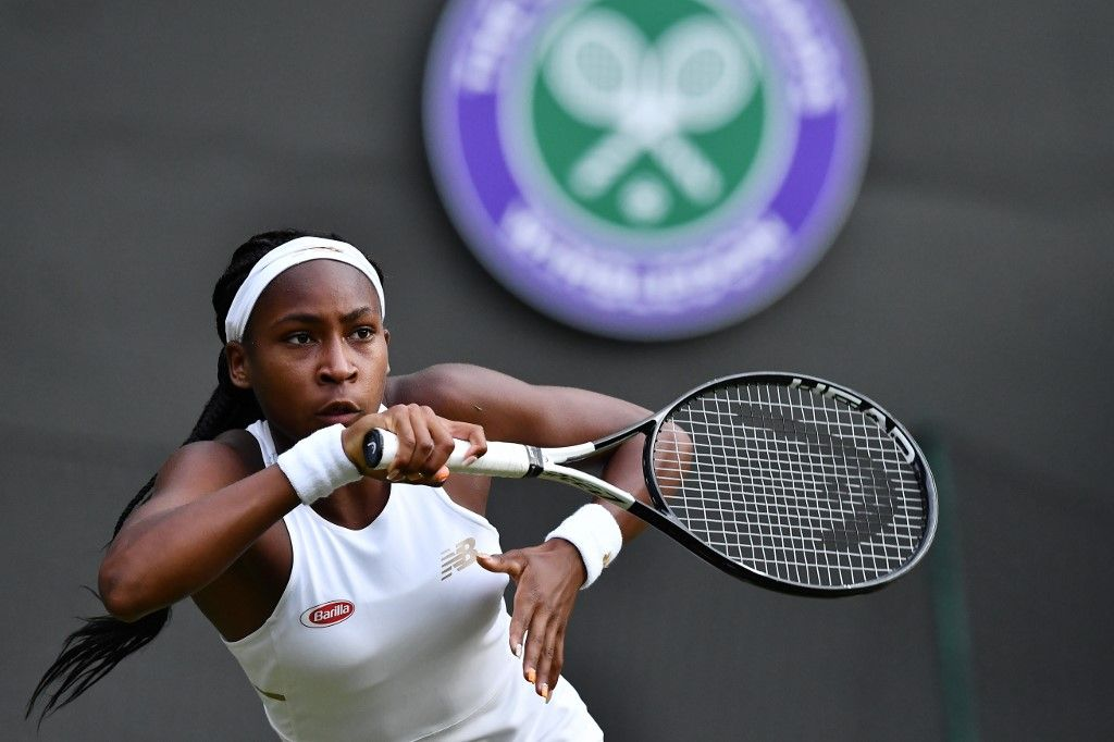US player Cori Gauff returns the ball to US player Venus Williams during their women's singles first round match on the first day of the 2019 Wimbledon Championships at The All England Lawn Tennis Club in Wimbledon, southwest London, on July 1, 2019. (Photo by Ben STANSALL / AFP) / RESTRICTED TO EDITORIAL USE
