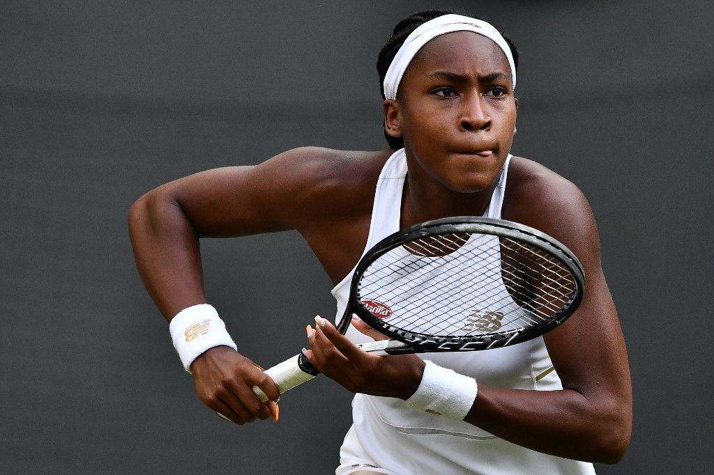 US player Cori Gauff slips runs to return against US player Venus Williams during their women's singles first round match on the first day of the 2019 Wimbledon Championships at The All England Lawn Tennis Club in Wimbledon, southwest London, on July 1, 2019. (Photo by Ben STANSALL / AFP) / RESTRICTED TO EDITORIAL USE