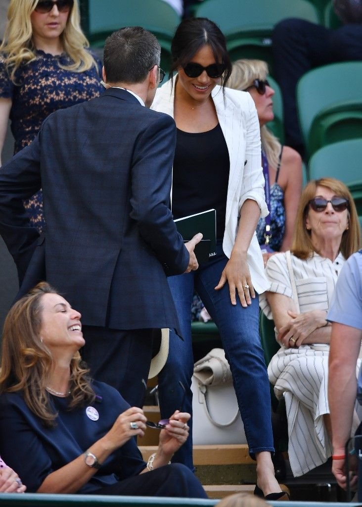 Britain's Meghan, Duchess of Sussex arrives to watch US player Serena Williams playing against Slovakia's Kaja Juvan during their women's singles second round match on the fourth day of the 2019 Wimbledon Championships at The All England Lawn Tennis Club in Wimbledon, southwest London, on July 4, 2019. (Photo by GLYN KIRK / AFP) / RESTRICTED TO EDITORIAL USE