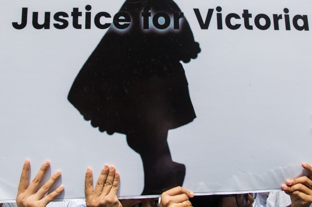 "Protesters hold a sign during the demonstration demanding justice for a two-year-old who was raped and given the pseudonym ""Victoria"" in front of the Central Investigation Department (CID) in Yangon on July 6, 2019. - Seven nurseries in Myanmar's capital remained closed as police charged a suspect for allegedly raping a two-year-old, a case that has horrified a country where experts say assaults on children are widespread. (Photo by Sai Aung MAIN / AFP)"