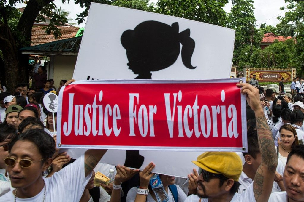 "Protesters take part in a demonstration demanding justice for a two-year-old who was raped and given the pseudonym ""Victoria"" in front of the Central Investigation Department (CID) in Yangon on July 6, 2019. - Seven nurseries in Myanmar's capital remained closed as police charged a suspect for allegedly raping a two-year-old, a case that has horrified a country where experts say assaults on children are widespread. (Photo by Sai Aung MAIN / AFP)"