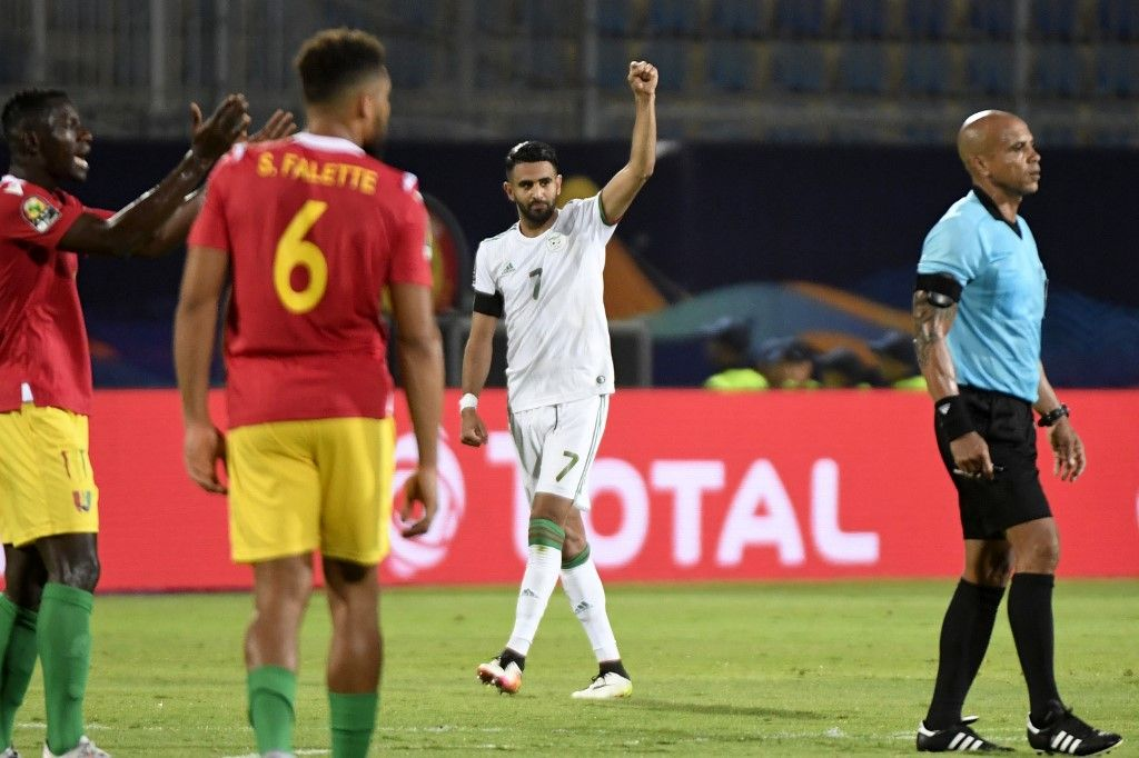 Algeria's forward Riyad Mahrez celebrates after scoring a goal during the 2019 Africa Cup of Nations (CAN) Round of 16 football match between Algeria and Guinea at the 30 June Stadium in the Egyptian capital Cairo on July 7, 2019. (Photo by Khaled DESOUKI / AFP)