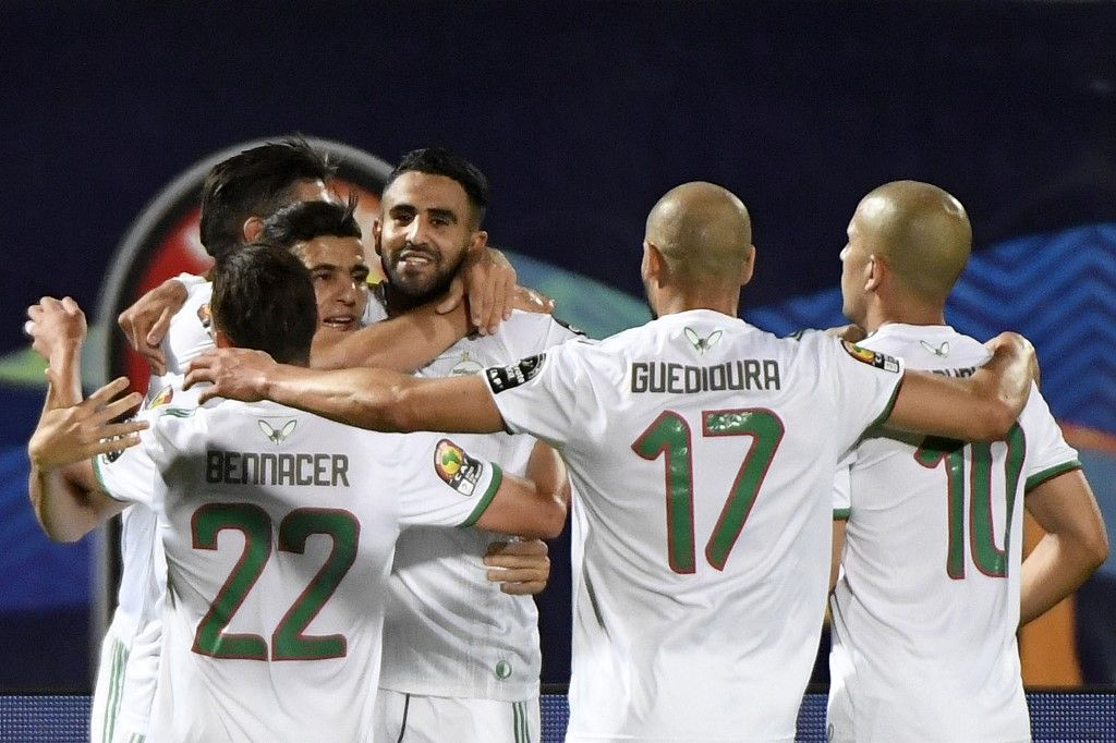 Algeria's forward Riyad Mahrez (4th-L) celebrates after scoring a goal during the 2019 Africa Cup of Nations (CAN) Round of 16 football match between Algeria and Guinea at the 30 June Stadium in the Egyptian capital Cairo on July 7, 2019. (Photo by Khaled DESOUKI / AFP)