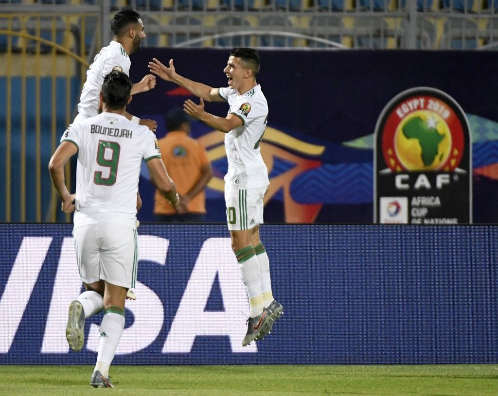 Algeria's forward Riyad Mahrez (2nd-L) celebrates after scoring a goal during the 2019 Africa Cup of Nations (CAN) Round of 16 football match between Algeria and Guinea at the 30 June Stadium in the Egyptian capital Cairo on July 7, 2019. (Photo by Khaled DESOUKI / AFP)