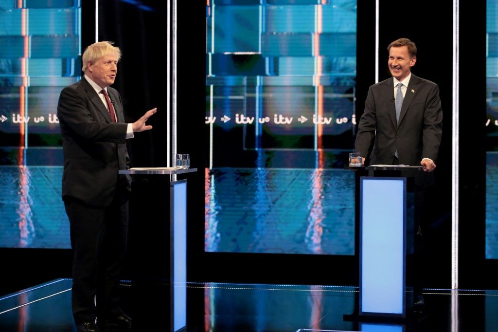 """Conservative leadership contenders Boris Johnson and Foreign secretary Jeremy Hunt (R) take part in Britain's Next Prime Minister: The ITV Debate in Manchester on July 9, 2019. (Photo by Matt Frost / ITV / AFP) / RESTRICTED TO EDITORIAL USE - MANDATORY CREDIT """"AFP PHOTO / ITV / MATT FROST """" - NO MARKETING NO ADVERTISING CAMPAIGNS - DISTRIBUTED AS A SERVICE TO CLIENTS --- NO ARCHIVE ---"""