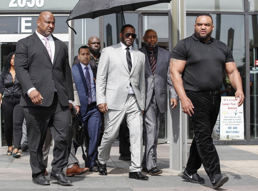 (FILES) In this file photo taken on June 6, 2019 Singer R. Kelly leaves the Leighton Criminal Court Building after a hearing on sexual abuse charges in Chicago. - R. Kelly has been arrested on child pornography and other charges, the New York Times reported, in the latest criminal investigation into the R&B superstar dogged by allegations of sexual misconduct. The 52-year-old, whose legal name is Robert Kelly, was taken into custody by federal agents in Chicago late on July 11, 2019, the newspaper said. (Photo by KAMIL KRZACZYNSKI / AFP)