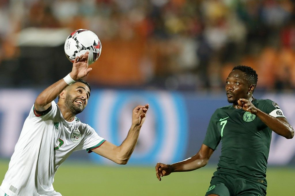 Algeria's forward Riyad Mahrez (L) vies for the ball with Nigeria's forward Ahmed Musa during the 2019 Africa Cup of Nations (CAN) Semi-final football match between Algeria and Nigeria at the Cairo International stadium in Cairo on July 14, 2019. (Photo by FADEL SENNA / AFP)