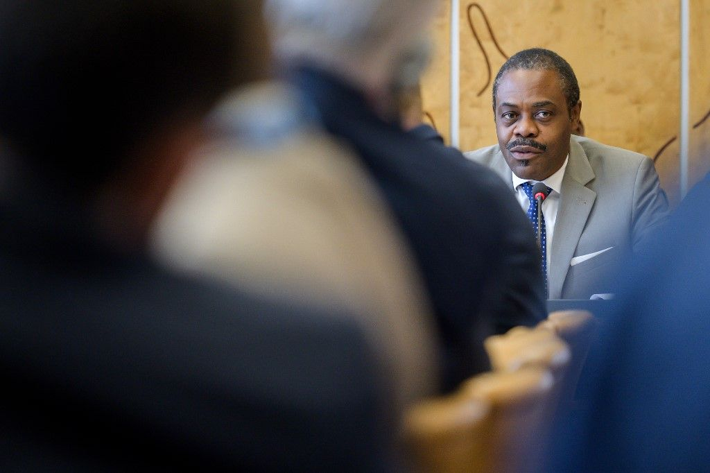 "Congo's Health Minister Oly Ilunga speaks during a meeting hold by the United Nations on the Ebola disease in Democratic Republic of Congo, on July 15, 2019, in Geneva. - A confirmed Ebola case in the key Democratic Republic of Congo city of Goma is ""a warning"" about the dangers of the outbreak, a top UN official said on July 15, 2019. ""Goma is a warning,"" the World Health Organization's emergencies chief, Mike Ryan, told reporters in Geneva, adding that response teams had identified 60 contacts of the evangelical preacher who fell ill in Goma and ""vaccinated 30 of them."" (Photo by FABRICE COFFRINI / AFP)"