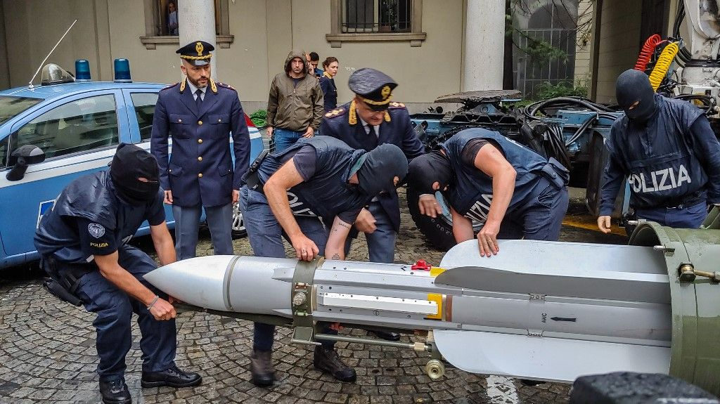 "This handout picture released by the Italian police (Polizia di Stato) of Turin, on July 15, 2019, shows italian policemen carry an air-to-air missile, as part of a big cache of guns and ammunition that was seized by the Turin special police force, called Digos, led the operations, assisted by police in Milan, Varese, Forli and Novara. - Anti-terrorism police in northern Italy have seized an air-to-air missile and other sophisticated weapons during raids on far-right extremist groups. (Photo by HO / Polizia di Stato / AFP) / RESTRICTED TO EDITORIAL USE - MANDATORY CREDIT ""AFP PHOTO / POLIZIA DI STATO - ITALIAN POLICE"" - NO MARKETING NO ADVERTISING CAMPAIGNS - DISTRIBUTED AS A SERVICE TO CLIENTS"