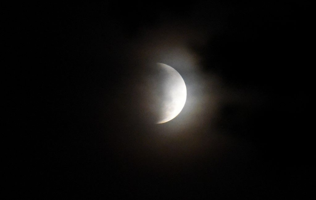 The moon is seen during a partial lunar eclipse in Asuncion, Paraguay, on July 16, 2019. (Photo by NORBERTO DUARTE / AFP)