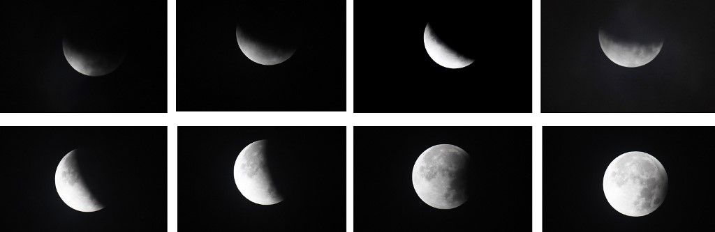 (COMBO) This combination of pictures created on July 17, 2019, shows the moon during different stages of a partial lunar eclipse as seen from Karachi. (Photo by ASIF HASSAN / AFP)