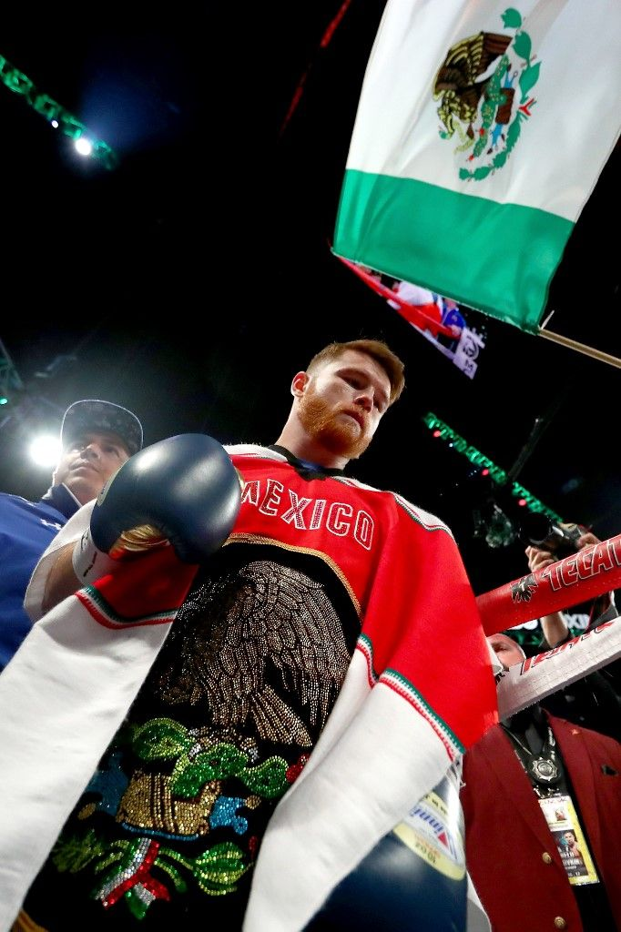 (FILES) In this file photo taken on September 16, 2017, Canelo Alvarez enters the ring to take on Gennady Golovkin before their WBC, WBA and IBF middleweight championship bout at T-Mobile Arena in Las Vegas, Nevada. - Alvarez has scrapped plans to fight in September after failing to line up a suitable opponent, the world middleweight champion announced on on July 17, 2019. Alvarez, the WBA, WBC and IBF champion, had been provisionally due to fight on September 14, maintaining a tradition of fighting on or around Mexico's Independence Day holiday. (Photo by AL BELLO / GETTY IMAGES NORTH AMERICA / AFP)
