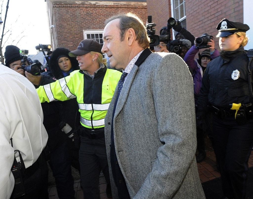 "(FILES) In this file photo taken on January 7, 2019 Kevin Spacey exits the courthouse after making an appearance during his arraignment on at the Nantucket District Court, in Nantucket, Massachusetts. - Prosecutors dropped sexual assault proceedings against Spacey on July 17, 2019, after the case against the Hollywood star collapsed over his alleged victim's refusal to testify. William Little had accused the 59-year-old actor of groping him in a bar on the resort island of Nantucket in July 2016. But Massachusetts prosecutors filed a formal notice of abandonment of indecent assault and battery charges due to ""the unavailability of the complaining witness,"" who had declined to give evidence due to fear of self-incrimination. (Photo by Joseph PREZIOSO / AFP)"