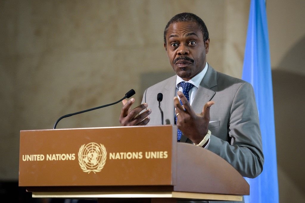 "(FILES) In this file photo taken on July 15, 2019 DR Congo's Health Minister Oly Ilunga gestures as he speaks during a press conference following a meeting hold by the United Nations on the Ebola disease in Democratic Republic of Congo, in Geneva. - DR Congo's Health Minister Oly Ilunga resigned on July 22, 2019, citing his removal as the head of his country's Ebola response and concerns over a proposed ""experiment"" with a new, unlicensed vaccine. (Photo by FABRICE COFFRINI / AFP)"