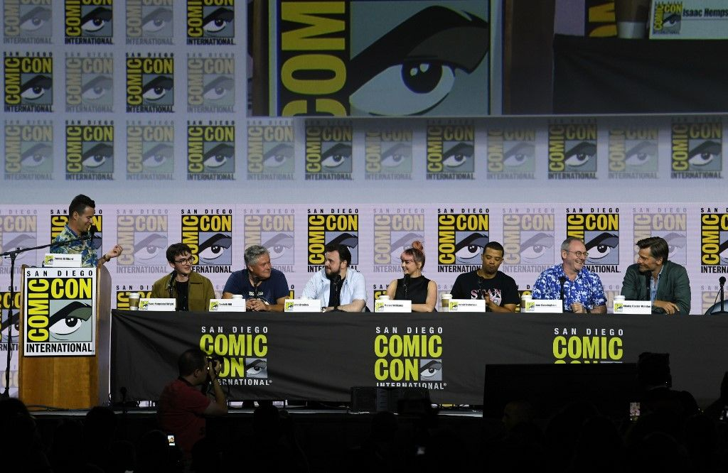 """SAN DIEGO, CALIFORNIA - JULY 19: (L-R) James Hibberd, Isaac Hempstead Wright, Conleth Hill, John Bradley, Maisie Williams, Jacob Anderson, Liam Cunningham and Nikolaj Coster-Waldau speak at the """"Game Of Thrones"""" Panel And Q&A during 2019 Comic-Con International at San Diego Convention Center on July 19, 2019 in San Diego, California. Kevin Winter/Getty Images/AFP"""