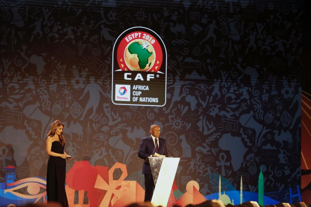 12 April 2019, Egypt, Giza: Ahmad Ahmad (R), President of the Confederation of African Football (CAF) delivers a speech on stage during the draw for the 2019 Africa Cup of Nations at the Pyramids of Giza. The Championship is scheduled to take place in Egypt between 21 June and 19 July 2019. Photo: Ahmed Ramadan/dpa (Photo by Ahmed Ramadan/picture alliance via Getty Images)