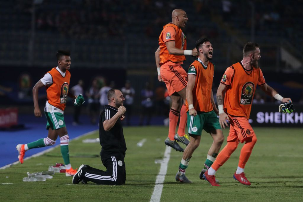 27 June 2019, Egypt, Cairo: Algeria's manager Djamel Belmadi (2-L) and players reacts on the touchline after the final whistle of the 2019 Africa Cup of Nations Group C soccer match between Senegal and Algeria at the 30 June Stadium. Photo: Oliver Weiken/dpa (Photo by Oliver Weiken/picture alliance via Getty Images)