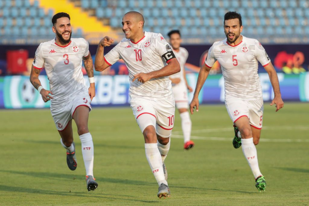 28 June 2019, Egypt, Suez: Tunisia's Wahbi Khazri (C) celebrates with his teammates Dylan Bronn (L) and Oussama Haddadi scoring his side's first goal during the 2019 Africa Cup of Nations Group E soccer match between Tunisia and Mali at Suez Sports Stadium. Photo: Oliver Weiken/dpa (Photo by Oliver Weiken/picture alliance via Getty Images)