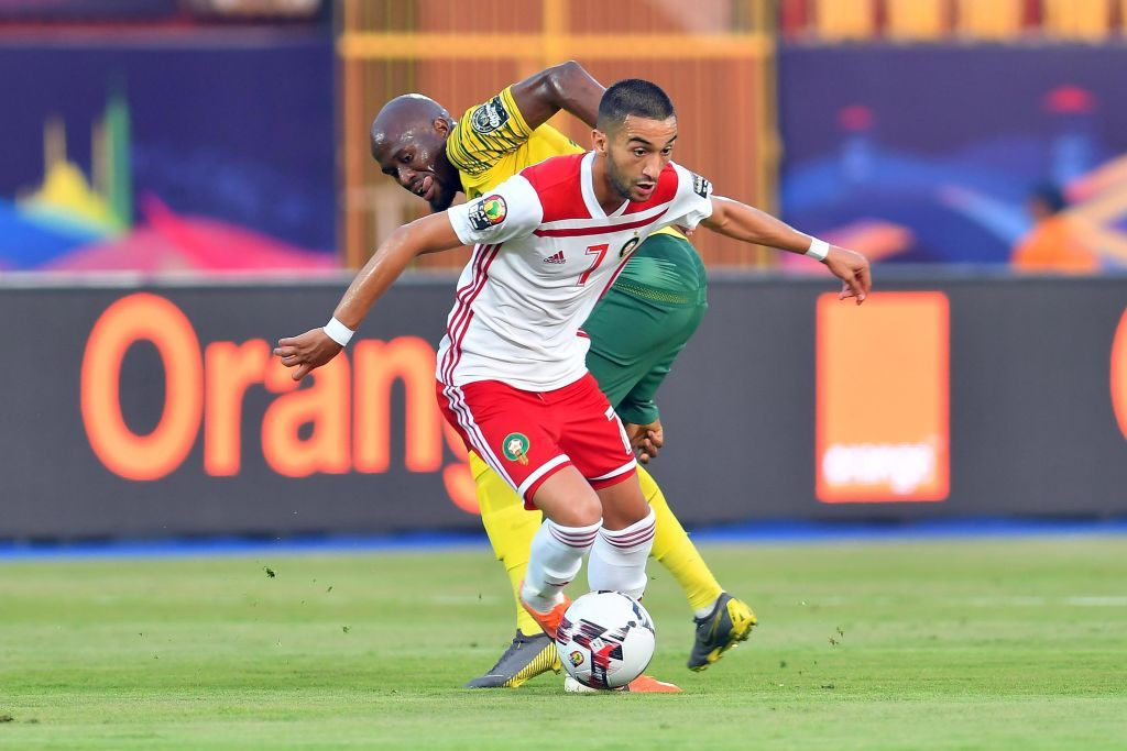 CAIRO, EGYPT - JULY 01: Hakim Ziyech of Morocco with Sifiso Hlanti of South Africa during the African Cup of Nations match between South Africa and Morocco at Al-Salam Stadium on July 01, 2019 in Cairo, Egypt. (Photo by Ahmed Hasan/Gallo Images/Getty Images)