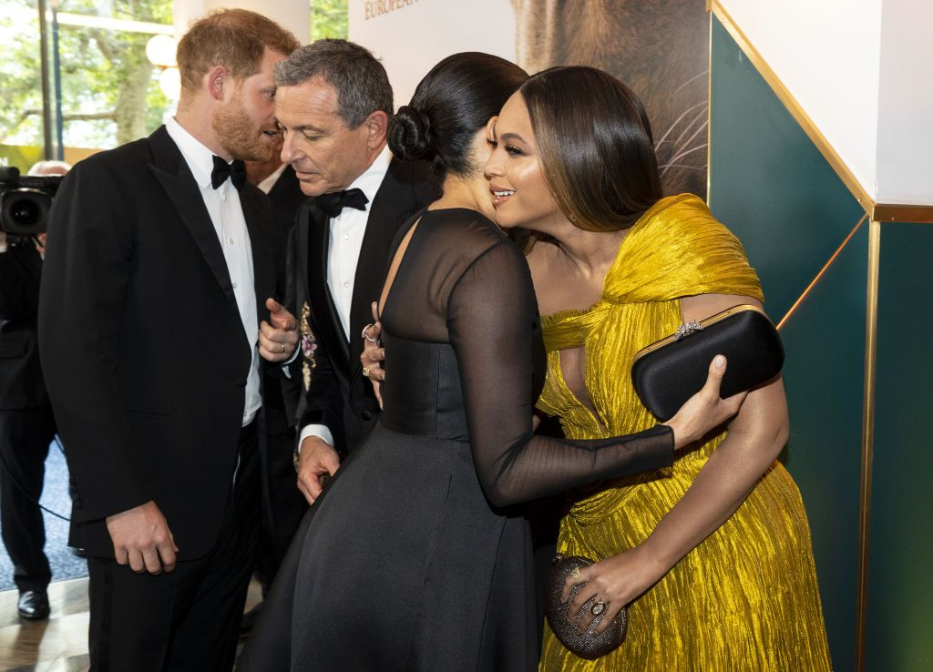 """LONDON, ENGLAND - JULY 14: Prince Harry, Duke of Sussex and Meghan, Duchess of Sussex greet Disney CEO Robert Iger US singer-songwriter Beyoncé at the European Premiere of Disney's """"The Lion King"""" at Odeon Luxe Leicester Square on July 14, 2019 in London, England. (Photo by Niklas Halle'n-WPA Pool/Getty Images)"""