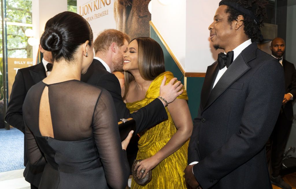 """LONDON, ENGLAND - JULY 14: Prince Harry, Duke of Sussex and Meghan, Duchess of Sussex greet US singer-songwriter Beyoncé and and US rapper Jay-Z at the European Premiere of Disney's """"The Lion King"""" at Odeon Luxe Leicester Square on July 14, 2019 in London, England. (Photo by Niklas Halle'n-WPA Pool/Getty Images)"""