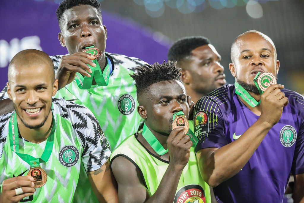 17 July 2019, Egypt, Cairo: Nigeria players celebrate after receiving a medal for winning the 2019 Africa Cup of Nations third place final soccer match between Tunisia and Nigeria at the Al-Salam Stadium. Photo: Omar Zoheiry/dpa (Photo by Omar Zoheiry/picture alliance via Getty Images)
