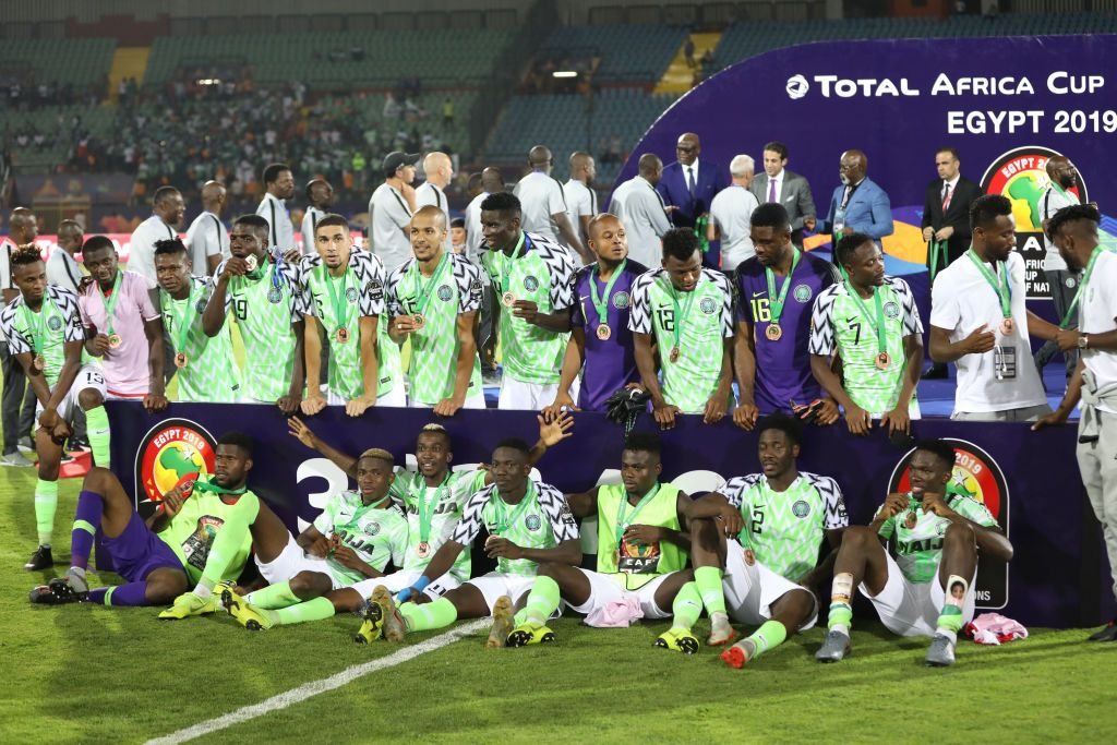 17 July 2019, Egypt, Cairo: Nigeria players celebrate after receiving a medal for winning the 2019 Africa Cup of Nations third place final soccer match between Tunisia and Nigeria at the Al-Salam Stadium. Photo: Gehad Hamdy/dpa (Photo by Gehad Hamdy/picture alliance via Getty Images)