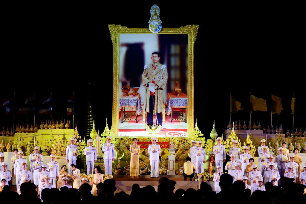 Thai Prime Minister Prayut Chan-o-cha holds light a candle in front of a large picture of Thai King Maha Vajiralongkorn during a ceremony to honor his 67th birthday at Sanam Luang in Bangkok, Thailand, 28 July 2019. (Photo by Anusak Laowilas/NurPhoto via Getty Images)