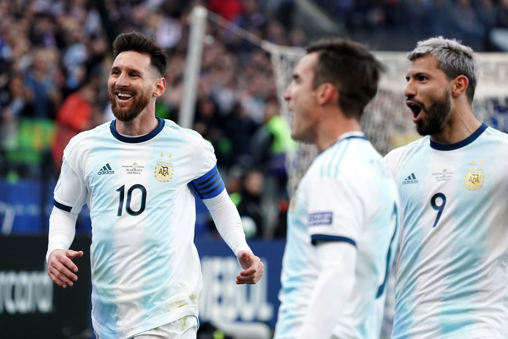 SAO PAULO, BRAZIL - JULY 06: Lionel Messi and Sergio Aguero celebrate the second goal of their team scored by teammate Paulo Dybala (not in frame) during the Copa America Brazil 2019 Third Place match between Argentina and Chile at Arena Corinthians on July 06, 2019 in Sao Paulo, Brazil. (Photo by Koji Watanabe/Getty Images)