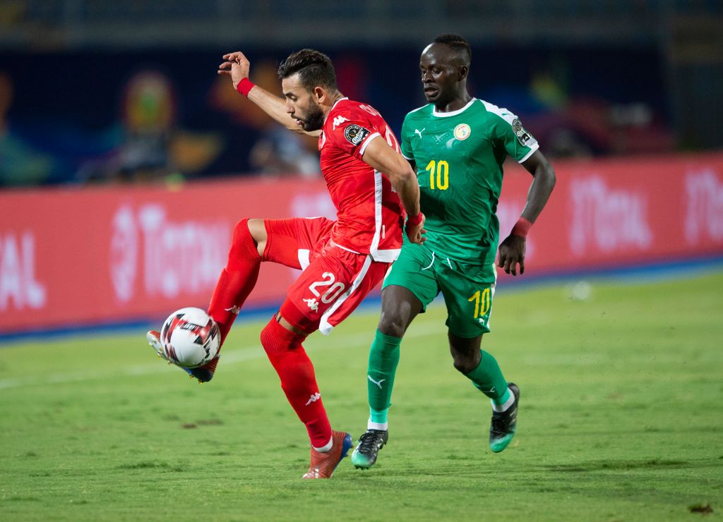 CAIRO, EGYPT - JULY 14: Ghaylen Chaaleli of Tunisia and Sadio Mané of Senegal during the 2019 Africa Cup of Nations Semi Final match between Senegal and Tunisia at 30th June Stadium on July 14, 2019 in Cairo, Egypt. (Photo by Visionhaus)