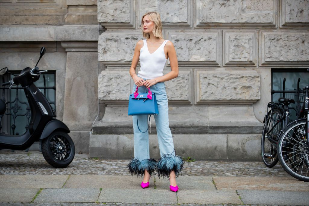 BERLIN, GERMANY - JULY 17: Mandy Bork is seen wearing white top Topshop, denim jeans with feathers Prada, purple heels Balenciaga, Hermes bag on July 17, 2019 in Berlin, Germany. (Photo by Christian Vierig/Getty Images)