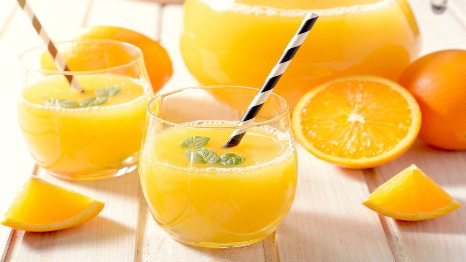 Fresh orange juice in the glasses,selective focus