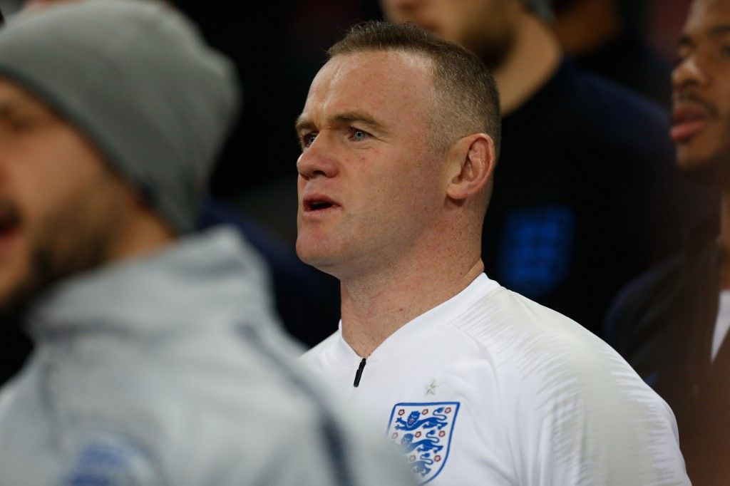 "(FILES) In this file photo taken on November 15, 2018 former England's striker Wayne Rooney sings the national anthem during the international friendly football match between England and the United States at Wembley stadium in north London. - Former England captain Wayne Rooney is to leave Washington-based DC United after agreeing a deal to become player-coach of the English Championship side Derby County, the club announced on August 6, 2019. ""Following the conclusion of the 2019 MLS season, star forward Wayne Rooney will be departing the club to continue his career in England in order to be closer to family,"" DC United said in a statement. (Photo by Ian KINGTON / AFP) / NOT FOR MARKETING OR ADVERTISING USE / RESTRICTED TO EDITORIAL USE"