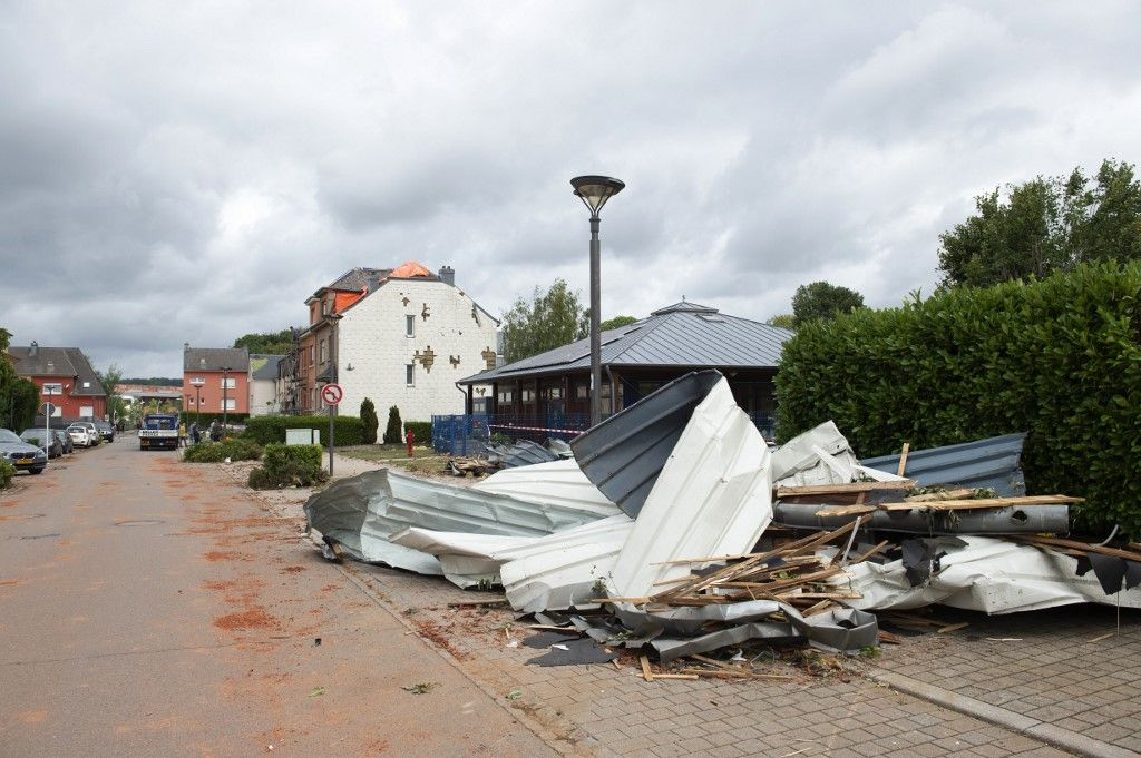A picture taken on August 10, 2019 in Bascharage shows the damages after a tornado ripped across the southern part of Luxembourg. (Photo by ANTHONY DEHEZ / BELGA / AFP) / Belgium OUT