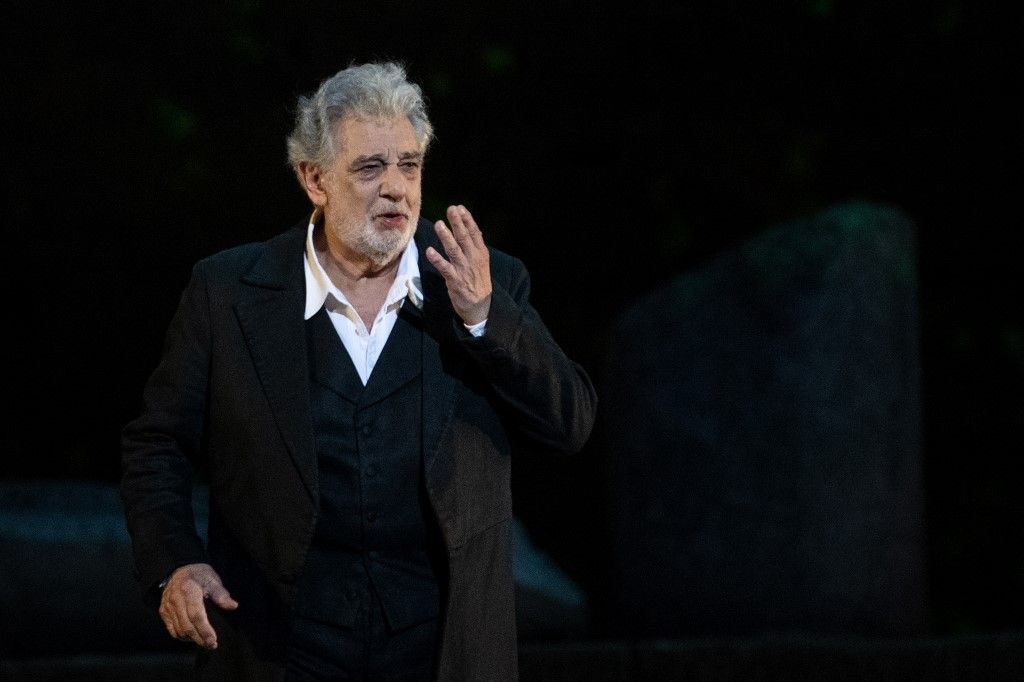 "(FILES) In this file photo taken on July 25, 2015 Spanish singer Placido Domingo performs on stage during a concert at the Starlite in Marbella. - Opera great Placido Domingo denied multiple allegations of sexual harassment on August 13, 2019, insisting that he believed all interactions and relationships throughout his long career ""were always welcomed and consensual."" (Photo by Christophe SIMON / AFP)"