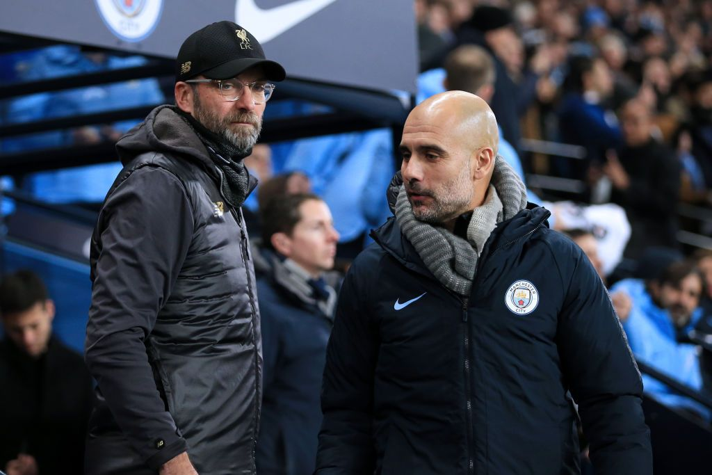 MANCHESTER, ENGLAND - JANUARY 03: Liverpool manager Jurgen Klopp (L) and Man City manager Pep Guardiola meet ahead of the Premier League match between Manchester City and Liverpool at the Etihad Stadium on January 3, 2019 in Manchester, United Kingdom. (Photo by Simon Stacpoole/Offside/Getty Images)
