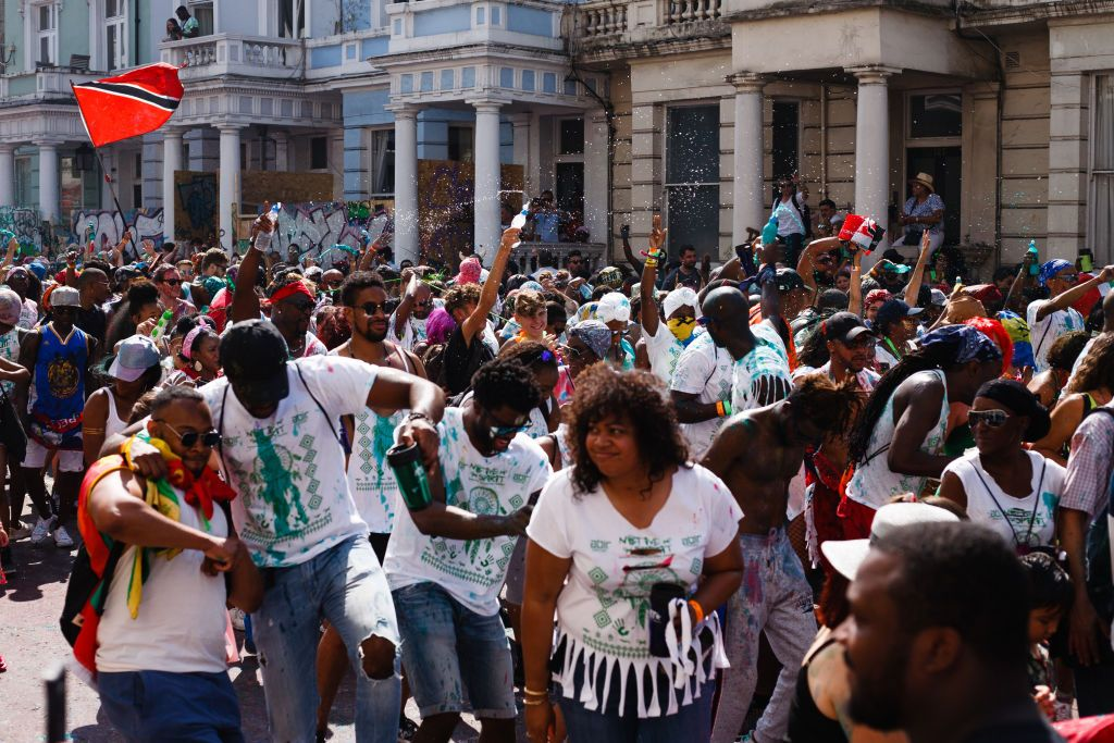 LONDON, UNITED KINGDOM - 2019/08/25: Revellers dance at Ladbroke Grove, during the opening day of the 2019 Notting Hill Carnival. Up to a million people are expected to pack the streets of Notting Hill and surrounding areas over the course of the two day event. The annual celebration of Afro-Caribbean culture takes place each August bank holiday weekend. (Photo by David Cliff/SOPA Images/LightRocket via Getty Images)