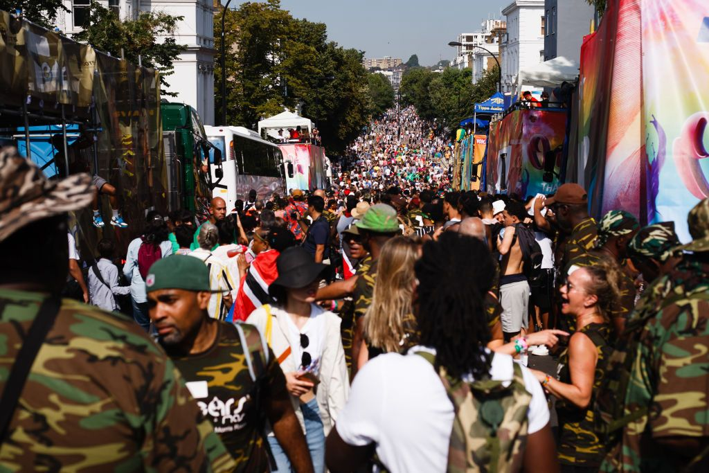 LONDON, UNITED KINGDOM - 2019/08/25: Revelers pack Ladbroke Grove during the opening day of the 2019 Notting Hill Carnival. Up to a million people are expected to pack the streets of Notting Hill and surrounding areas over the course of the two day event. The annual celebration of Afro-Caribbean culture takes place each August bank holiday weekend. (Photo by David Cliff/SOPA Images/LightRocket via Getty Images)