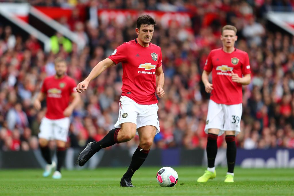 MANCHESTER, ENGLAND - AUGUST 11: Harry Maguire of Manchester United on the ball during the Premier League match between Manchester United and Chelsea FC at Old Trafford on August 11, 2019 in Manchester, United Kingdom. (Photo by Julian Finney/Getty Images)