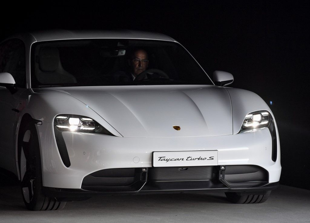 The Porsche Taycan electric car is presented to the public as a world premiere on September 4, 2019 in a hall of the airfield of Neuhardenberg, eastern Germany. - The first pure electric model is presented at the same time on three continents and will be delivered at the end of the year, staring in the USA. (Photo by Patrick Pleul / dpa / AFP) / Germany OUT