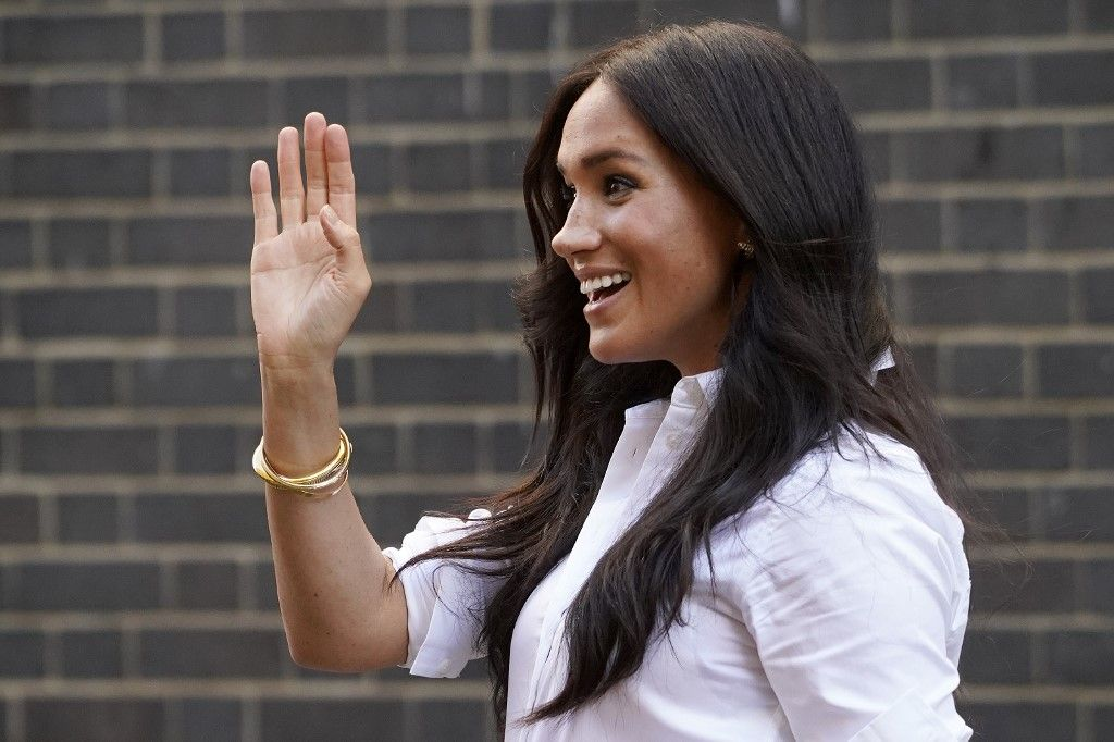 "Meghan, Duchess of Sussex, leaves after launching the Smart Works capsule collection in London on Septemeber 12, 2019. - Created in September 2013 Smart Works exists to help unemployed women regain the confidence they need to succeed at job interviews, return to employment and transform their lives. (Photo by Niklas HALLE'N / AFP) / CORRECTING BYLINE   ""The erroneous mention[s] appearing in the metadata of this photo by ANDY BUCHANAN                        have been modified in AFP systems in the following manner: [Byline is Niklas Hall'en] instead of [ANDY BUCHANAN].   Please immediately remove the erroneous mention[s] from all your online services and delete it (them) from your servers. If you have been authorized by AFP to distribute it (them) to third parties, please ensure that the same actions are carried out by them. Failure to promptly comply with these instructions will entail liability on your part for any continued or post notification usage. Therefore we thank you very much for all your attention and prompt action. We are sorry for the inconvenience this notification may cause and remain at your disposal for any further information you may require."""